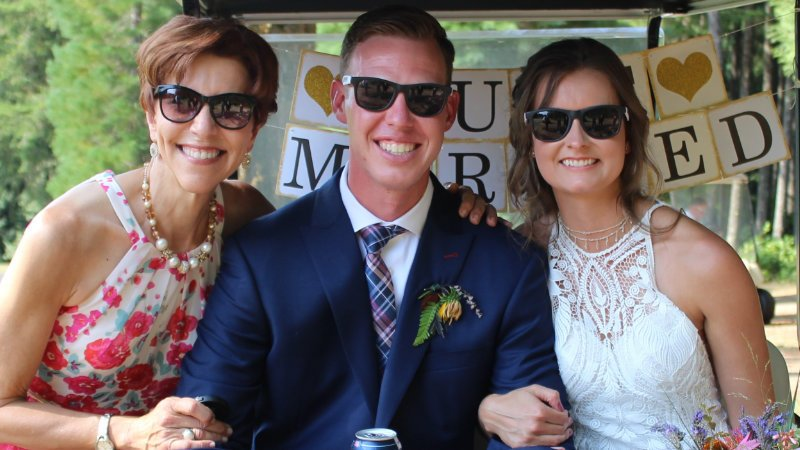 Annemarie Juhlian, Seattle Wedding Officiant in a golf cart with a newly married couple