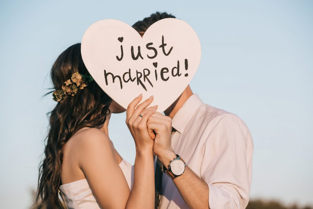 Just Married Couple holding Just Married Sign